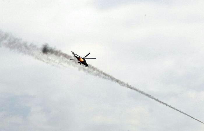 تصویر حمله بالگردهای ارتش عراق به مواضع و انبارهای مهمات داعش
