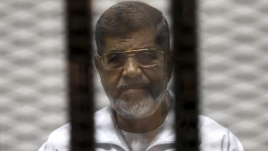 تصویر افتخار پسر محمد مرسی، رئیس جمهور سابق مصر به قتل عام شیعیان و قتل شهید شیخ حسن شحاته