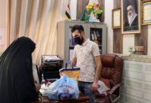 تصویر توزیع کمک های رمضانی هیئت فرهنگی صادقیه در شهر بصره