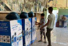 تصویر توزیع کولرهای آبی میان نیازمندان شهر مقدس کربلا توسط موسسه حضرت ام البنین سلام الله