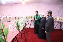 تصویر برپایی نمایشگاه قرآنی در جاده زائران در عراق