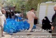 تصویر توزیع بسته های مواد غذایی میان نیازمندان شهر مقدس کربلا از سوی مؤسسه کفالة الیتیم